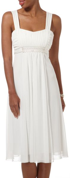 This tie back white dress would be perfect for a beach wedding