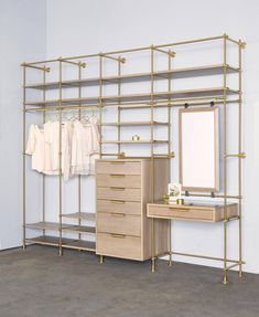 For Sale on - Four bays of Amuneal's collector's shelving system is used to create this modular wardrobe unit with silvered oak shelves, dresser, vanity table and mirror. Open Wardrobe, Diy Wardrobe, Wardrobe Design, Hanging Wardrobe, Wardrobe Sale, Wardrobe Capsule, Holiday Wardrobe, Wardrobe Ideas, Fall Wardrobe