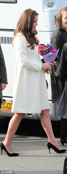 Looking around: The Duchess' first stop was at the make-up trailer where she watched Mrs H...