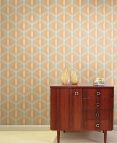 $30.46 Price per roll (per m2 $5.71), I love the 70s , Carrier material: Non-woven wallpaper, Surface: Fine structure, Vinyl, Look: Matt, Design: Retro ornaments, Basic colour: Cream, Pattern colour: Grey beige, Orange, Characteristics: Good lightfastness, Highly wash-resistant, Low flammability, Strippable, Paste the wall