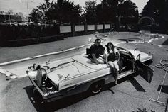 Country music star Webb Pierce and companion Vickie Vanderpool pose in 1978 on his customized 1962 Pontiac convertible near Pierce's new guitar-shaped pool on Music Row. The $100,000 car was a secondary attraction kept at the pool he opened for tourists to view but not to swim in.