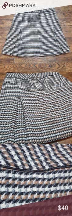 Talbots Wool Pleated Skirt Lined wool skirt that can match with all your neutrals in your closet. 19.5 inches long and waist is 15 inches across. Size 2. 57% wool, 38% viscose, 5% nylon and shell is 100% polyester. Talbots Skirts Mini