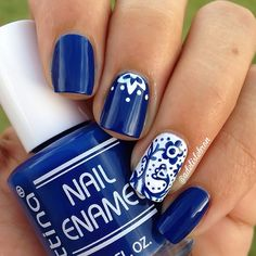 Cobalt blue nails with china-pattern accent nail.