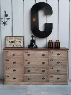 refinished industrial chic dresser, vintage metal plaque, oversized wall-mounted initial.