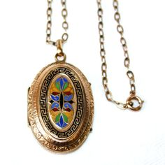 Early 1900s gold-filled locket with ornate enameled front, engraved floral designs on back and sides, hangs from a 17 long gold-filled link