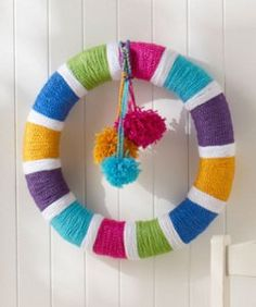 All Year Rainbow Wreath | AllFreeCrochet.com Good way to use up the yarn stash