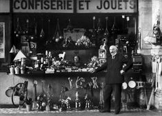 Georges Méliès with Jeanne d'Alcy at his toy shop at the Montparnasse station in Paris, 1929.