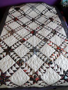 Classic traditional design using a variety of different oriental prints, each large block was made using a different oriental print. The back of the quilt is floral on beige. Machine-pieced and machin