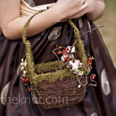 Josie's young cousin wore a chocolate and taupe polka dotted dress and carried a moss-wrapped basket.