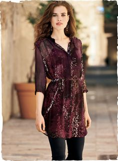 Alpine flowers are strewn across the crinkled silk chiffon tunic. Printed in heart-throb hues for a darkly romantic effect. Banded collar; ¾-sleeves; waist tie; pockets; back-dipping shirttail hem. Includes a separate camisole.