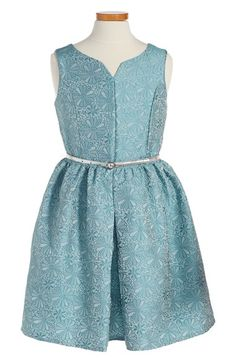 Pippa & Julie Floral Fit & Flare Dress (Big Girls) at Nordstrom.com. A fit-and-flare dress with a touch of vintage style features a shimmery floral pattern, a notched neckline and an inverted pleat for extra fullness at the skirt. A silvery belt ties the pretty look together.