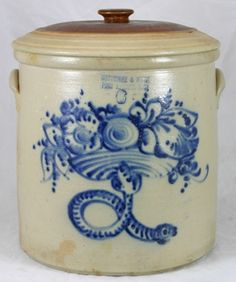"SOLD - $ 11,550 Sept 2009 SATTERLEE & MORY FORT EDWARD NY 6 gallon crock.  Decorated with a great folk art treasure of a coiled snake holding a compote of flowers. Desirable image seen in other American Folk Art mediums. Fitted with a matching stoneware crock lid.    Interior lime staining from use. There are a few old flake spots in the glaze.   13"" 1870"