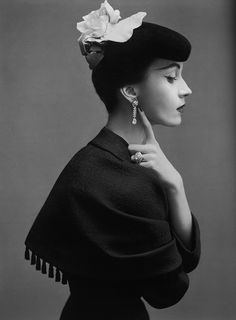 Dovima, October 1950. Wearing Cristóbal Balenciaga's suit with capelet of black silk satin matelassé. Photographed by Richard Avedon.