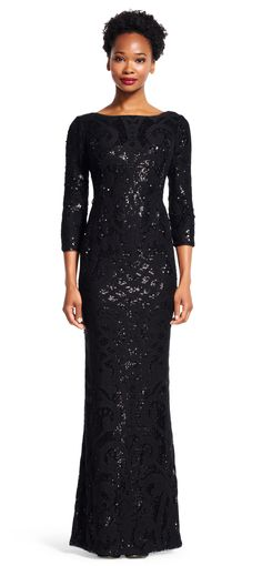 Glittering scales of sequins line this gorgeous mermaid gown from top to bottom. Shimmering over luxurious lace, this siren of an evening dress is perfect for your next formal event. Featuring a boat neckline, three-quarter length sleeves, and a v-back, this long dress is epitome of effortless elegance. A long slit at the back of this formal dress completes the design.