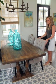 We collaborated with Southern Living to design this Habersham, South Carolina dining room. Drawing inspiration from the coastal surroundings, designer Anne Hagerty used sea-blue, sandy and grey tones. She combined slightly rustic elements with chic and sleek and the results are a stunning room where you want to spend lots of time.