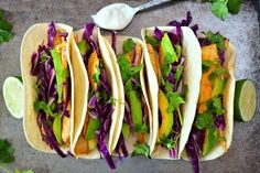 """We're putting a healthy twist on the great tradition known as """"Taco Tuesday""""! These tempting tacos are wrapped in a warm tortilla, topped with avocado, red cabb Fish Tacos With Cabbage, Spicy Fish Tacos, Grilled Fish Tacos, Cabbage Slaw, Red Cabbage, Tilapia Tacos, Ravioli Lasagna, White Fish Recipes, Cancer Fighting Foods"""