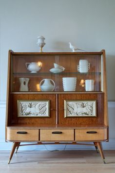 Found this gorgeous mid-century hutch at the awesome Strange Closets blog.