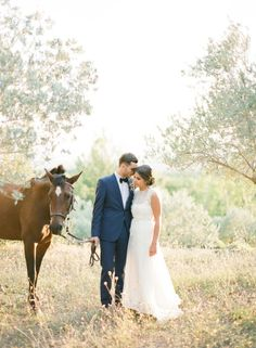 Bride and groom outdoor portraits with horse