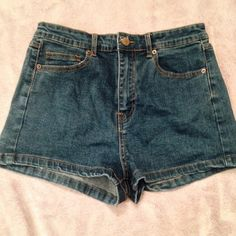High Waisted Denim Shorts High Waisted Denim shorts in neutral jean color. never worn NWOT. cotton and polyester material- strechy and soft Forever 21 Shorts Jean Shorts