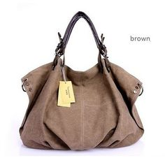 """Soft, Canvas Handbag / Shoulder Bag with great leather handles and lots of compartments for all your essentials. Size: 26"""" width, 14"""" height, 6"""" depth. Material: Canvas / Leather"""