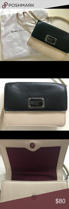 Marc Jacobs Cross Body Bag! Super cute black and beige cross body bag with an adjustable/ detachable strap! Has a magnetic closure and small pocket inside. Also has a maroon, fabric interior. Marc Jacobs dust bag included!  Feel free to make an offer! Marc Jacobs Bags Crossbody Bags