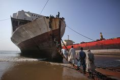 The Ship Breakers - In Focus - The Atlantic Laborers climb up an iron chain and ladder to break down a ship for scrap metal at the Gaddani ship breaking yard in Pakistan on November 24, 2011. (Reuters/Akhtar Soomro)