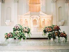 Romantic blooms by @kellyoshiro covered our Main Hall. (Venue: @redbirdla | @vibianaevents / Planner: @loveandsplendor / Photo: @erichmcvey / Floral: @kellyoshiro / Cake: @sweetnsaucyshop / Chargers: @casadeperrin / Entertainment: @redshoela)