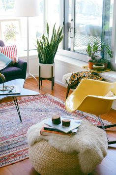 Indoor plant - check, Colourful Eames Chair - check, Sheepskin Rug - check...perfect. Tumblr