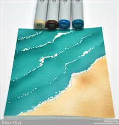 4. Beach/Wave Tutorial- I used a white Kirarina Wink pen to stipple and dab foam on the wave edges. While it was still wet, I sprinkled  iridescent glitter on the white foam for a little extra sparkle.  (MFT_FuninSun1h_sm_Deb-Olson).