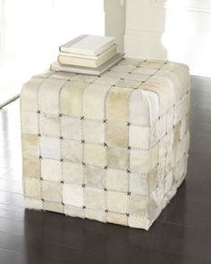 Would you happen to have two of these please?  No worries, I will add the feet to them.  OH!  And I will need those black little strange exes cut off.    Ivory Hairhide Pouf at Neiman Marcus.