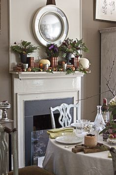 Autumn Mantle.  Love the old books with the pumpkins and greens.  I would edit this down a bit.