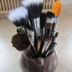 1 tsp olive oil + 1 tsp dish soap + 1 tsp water on a plate and swirl the brushes around til clean!