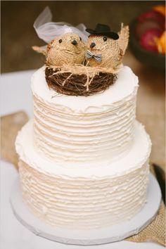 burlap bird cake topper on white textured cake #weddingcake #caketopper #weddingchicks http://www.weddingchicks.com/2014/02/20/outdoor-romance-wedding/