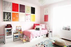 This Designer's Home Is Almost Better Than Her Jewels #refinery29 http://www.refinery29.com/the-glow/2#slide-11 Drew's art-filled bedroom. Room & Board Bed, available at Room & Board; Pottery Barn Kids Play Kitchen, availabl...