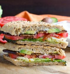 This is a copycat recipe for the Whole Foods TTLA sandwich. Crisp butter lettuce, juicy tomatoes, tangy tempeh bacon, creamy avocado, and zesty garlic aioli in a pressed ciabatta roll will be your new favorite sandwich! Vegan.