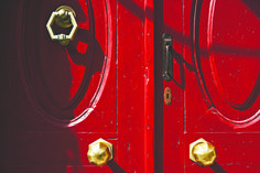"EXCLUSIVE SUITES BOUTIQUE HOTEL. MEDIEVAL TOWN, RHODES, GREECE. -  Our red front door. Older than one hundred years, made of ""katrani"", a very durable, now extinct kind of cypress wood. It was mainly used for boat keels and roof beams. We found the brass handles and knocker in a scrap yard. The iron latch was hand-forged in Italy.  - kokkiniporta.com Rhodes Hotel, Roof Beam, Cypress Wood, Medieval Town, Brass Handles, Extinct, Byzantine, Beams, Modern Design"