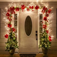 Christmas Door Decorating Ideas Christmas Door Decorating Ideas - Beautiful Christmas decorations for the porch created using lighted branches and red poinsettias! Front Door Christmas Decorations, Diy Christmas Lights, Christmas Front Doors, Beautiful Christmas Decorations, Simple Christmas, Christmas Diy, Christmas Porch Ideas, Christmas Lights Outside, Christmas Decorating Ideas