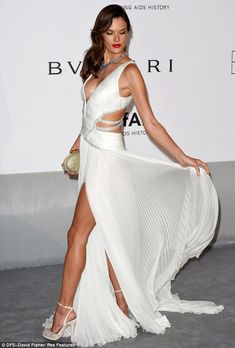 Alessandra Ambrosio is a fallen angel at amfAR in plunging white gown #dailymail
