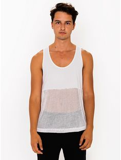 A versatile tank top featuring a deep scoop neck and a light, open knit mesh bottom.