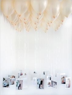 - An easy, affordable way to show off your photos at your bridal shower /wedding / birthday / baby shower (could even turn into game with everyone submitting their baby photos before and adding numbers to the balloon). Balloon chandeliers are sweet, but would vary the length of string more so that you can see the photos....