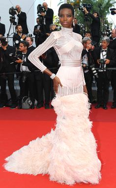 MARIA BORGES in a Balmain bombshell on The Beguiled red carpet in her custom blush feathered gown. - 2017 Cannes Film Festival