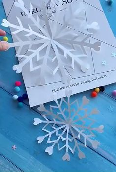 Mar 2020 - easy way to DIY a spining snowflake with hearts Diy Christmas Snowflakes, Christmas Paper Crafts, Holiday Crafts, Christmas Diy, Christmas Decorations, Easy Snowflake, Cut Out Snowflakes, Diy Snowflake Decorations, Making Paper Snowflakes