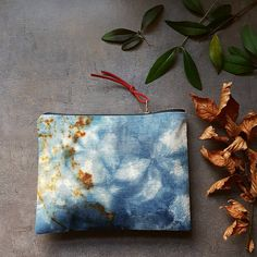 Indigo dyed and rust printed linen pouch . I like those colours together | by red2white