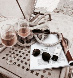 CUTE holiday inspiration, glasses of rose wine on the beach with and a magazine