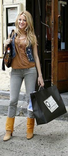 She's wearing: * BCBG denim vest * Neesa t-shirt * Wrangler jeans  Accessories: * Gucci Multicolor Indy bag with metal plate details