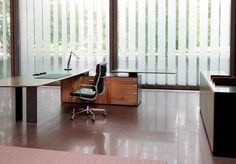 Simple Office Chair and Table with large windows and office cupboard