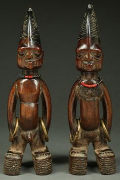 Exceptional Pair of Twins, ere ibeji, Ajasse Igbomina. Yoruba Tribe, Nigeria (female with rare medicinal application). Vetted as authentic by a committee of tribal art experts, purchase includes complete dossier and certificate of authenticity. In our years, we have yet to see a pair of ibeji in which one or both of the twins has a medicinal application applied to its surface. This and more ethnographic art for sale on CuratorsEye.com.