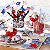 Edible 4th of July Centerpiece:  Show off pride for our country with this adorable and delectable centerpiece. In honor of the date, display a metal 4 house number inside a vase filled with holiday-color candies. Insert classic sparklers or berry skewers decorated with colorful ribbon flags.