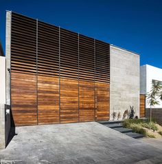 Image 16 of 21 from gallery of Cima House / GARZA IGA Arquitectos. Photograph by Garza Iga Arquitectos Architecture Details, Interior Architecture, Architectural Materials, Wooden Shutters, House Built, Residential Architecture, Cladding, Sustainability, House Design