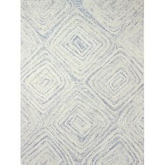 Stylist's Tip: Hand-tufted rugs offer an artisan feel with their beautifully detailed patterns and textured piles. Let this wool design bring a subtle p...